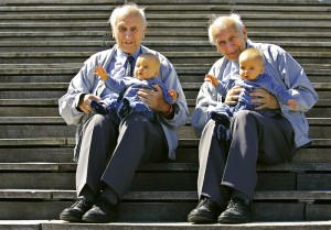 Alf Fehnhann (L) and 79-year-old twin brother Sven hold seven-month-old Luis Carl Millgramm (2nd L) ..