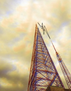 Low angle view of radio tower and signal