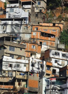 Giant photographs of women cover the walls of homes in favela Providencia in Rio de Janeiro